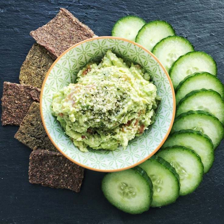 guacamole with crackers and cucumber dip